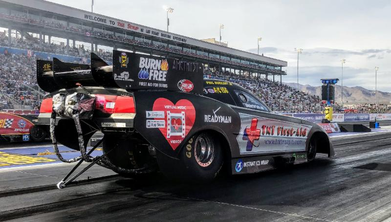 Phil burkart tnt first aid funny car just misses four for Las vegas motor speedway drag strip